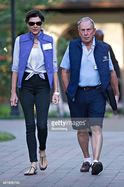 Michael 'Mike' Bloomberg Bloomberg LP founder and former mayor of New York City right walks with Diana Taylor while arriving for a morning session...