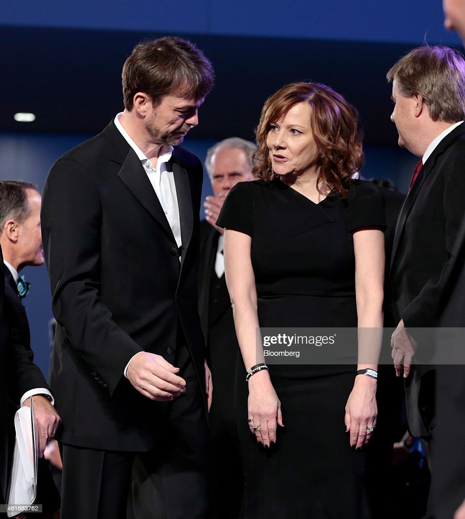 Michael 'Mike' Manley, chief executive officer of Chrysler Group LLC's Jeep brand, left, talks with Mary Barra, chief executive officer of General Motors Co. (GM), at the Charity Preview for North American International Auto Show (NAIAS) in Detroit, Michigan, U.S., on Friday, Jan. 16, 2015. Since 1976, the Charity Preview has raised more than $100 million for Southeastern Michigan children's charities. Photographer: Jeff Kowalsky/Bloomberg via Getty Images