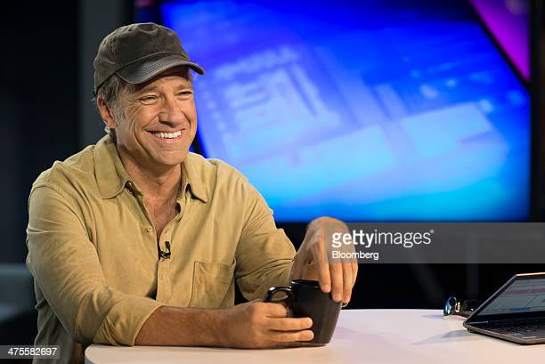 Michael 'Mike' Rowe former host of 'Dirty Jobs' smiles during a Bloomberg West Television interview in San Francisco California US on Thursday Feb 27...