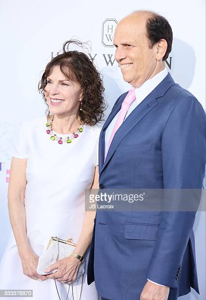 Michael Milken and Lori Anne Milken attend the Kaleidoscope Ball held at 3LABS on May 21 2016 in Culver City California