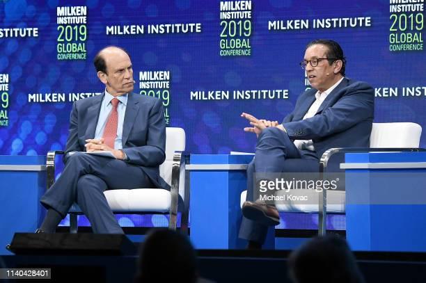 Michael Milken Chairman Milken Institute and Rajeev Misra CEO SoftBank Investment Advisers participate in a discussion during the annual Milken...
