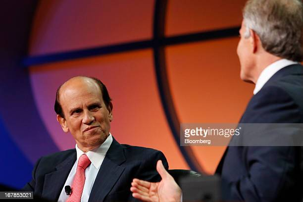 Michael Milken chairman of the Milken Institute left listens during an interview with Tony Blair former UK prime minister at the Milken Institute...
