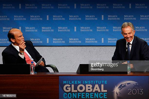 Michael Milken chairman of the Milken Institute left speaks during an interview with Tony Blair former UK prime minister at the Milken Institute...