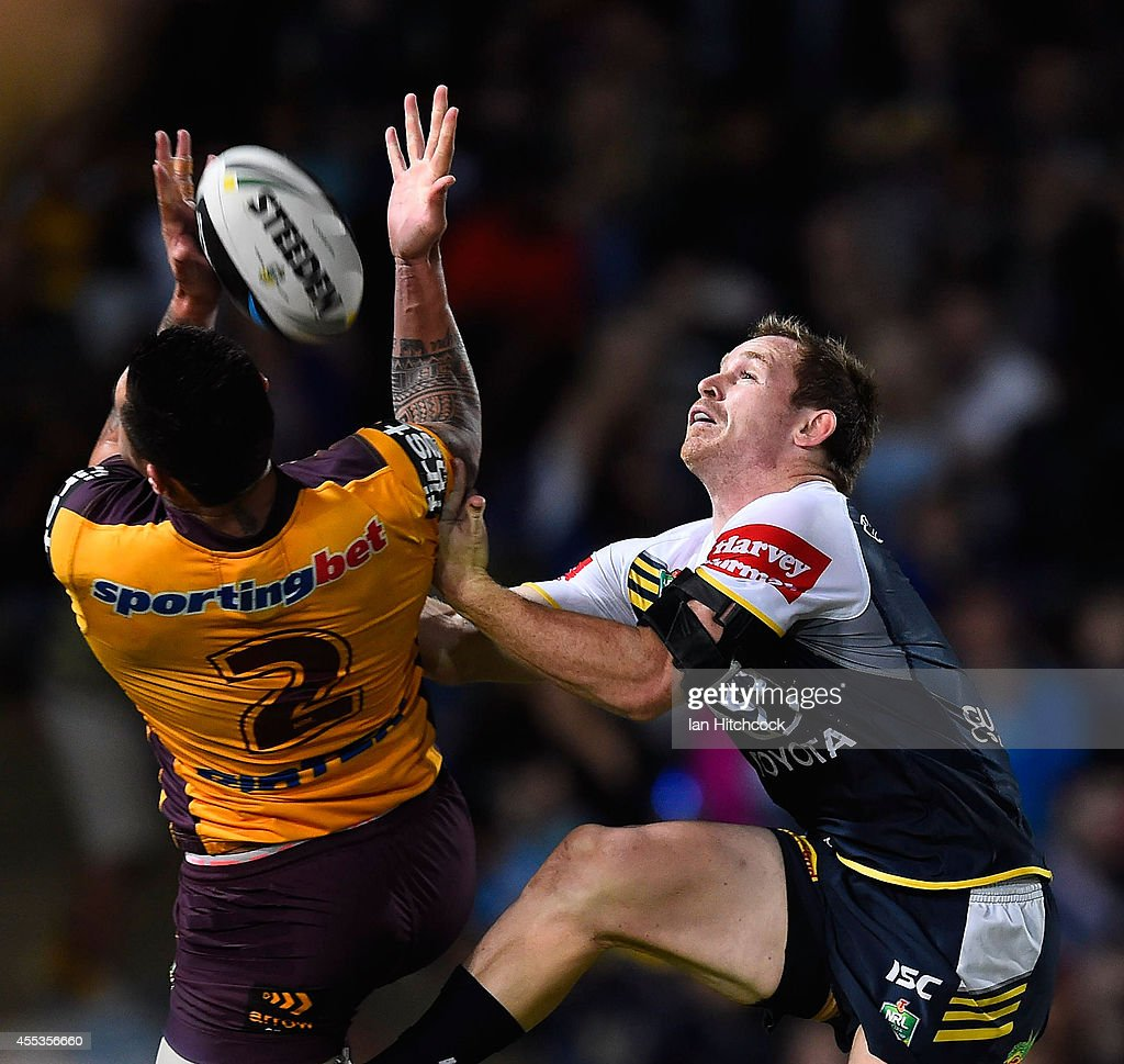 Michael Mogan of the Cowboys contests a high ball with Daniel Vidot of the Broncos during the NRL 1st Elimination Final match between the North Queensland Cowboys and the Brisbane Broncos at 1300SMILES Stadium on September 13, 2014 in Townsville, Australia.