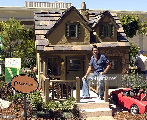 Michael Moloney from Extreme Makeover Home Edition stand in front of the Extreme Makeover Playhouse that was inspired by his design