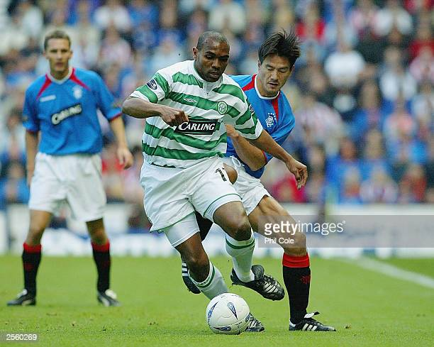 Michael Mols of Rangers gets to grips with Didier Aathe of Celtic during the the Scottish Premier division match between Rangers and Celtic at Ibrox...