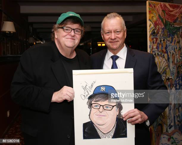 Michael Moore and Max Klimavicius during the Michael Moore And Michael Mayer portrait unveilings as they join the Wall of Fame at Sardi's on...