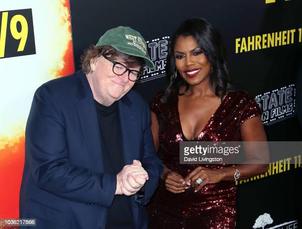 Michael Moore and Omarosa Manigault Newman attend the premiere of Briarcliff Entertainment's Fahrenheit 11/9 at Samuel Goldwyn Theater on September...