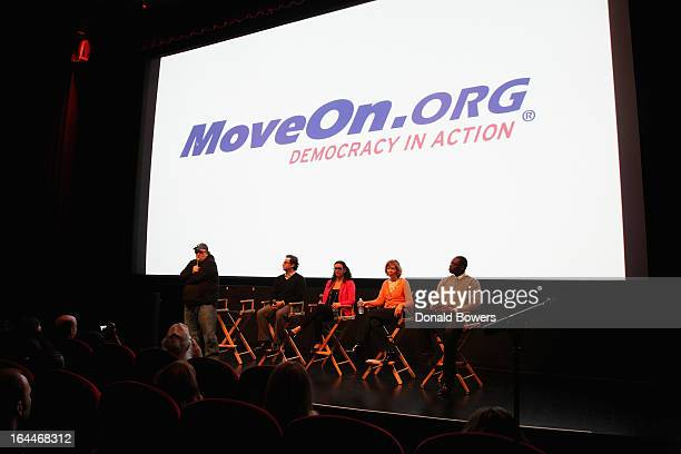 Michael Moore, Rob Wilcox, Jaime Pessin, Lori Hass and Garlin Gilchrist II attend The MoveOn.org Movie Screening And Panel On Reducing Gun Violence...