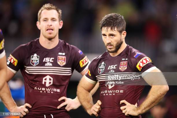 Michael Morgan and Ben Hunt of the Maroons look dejected after defeat during game two of the 2019 State of Origin series between the New South Wales...
