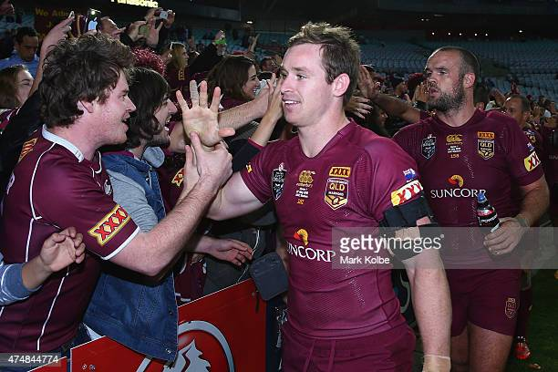 Michael Morgan and Nate Myles of the Maroons celebrate victory with the crowd during game one of the State of Origin series between the New South...