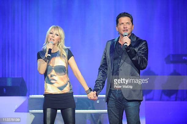 Michael Morgan and Rosanna Rocci perform on stage during the 'Schlagernacht 2011' at the LanxessArena on April 16 2011 in Cologne Germany