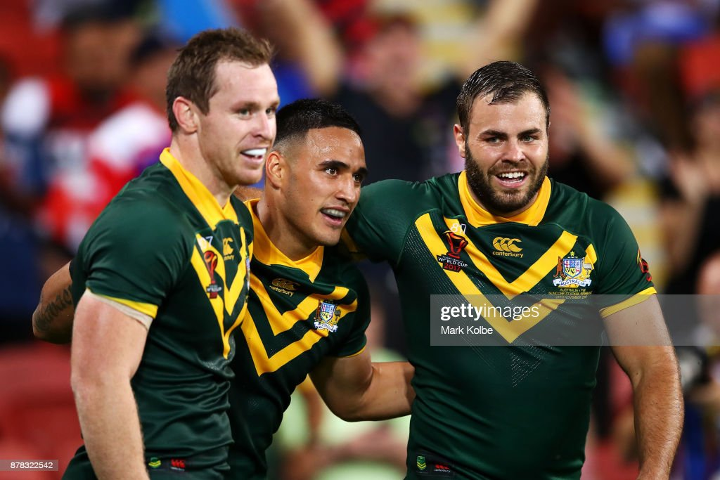 Michael Morgan (L) and Wade Graham (R) of Australia celebrates with Valentine Holmes of Australia after he scored his seventh try during the 2017 Rugby League World Cup Semi Final match between the Australian Kangaroos and Fiji at Suncorp Stadium on November 24, 2017 in Brisbane, Australia.