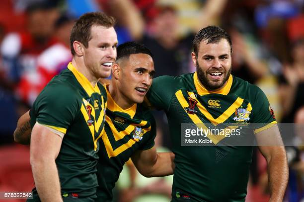 Michael Morgan and Wade Graham of Australia celebrates with Valentine Holmes of Australia after he scored his seventh try during the 2017 Rugby...