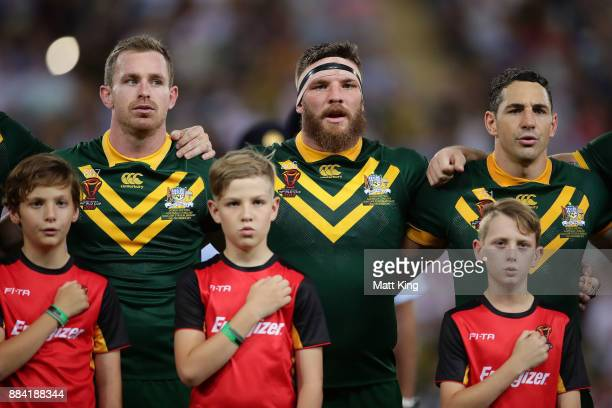 Michael Morgan Josh McGuire and Billy Slater of the Kangaroos sing the national anthem before the 2017 Rugby League World Cup Final between the...