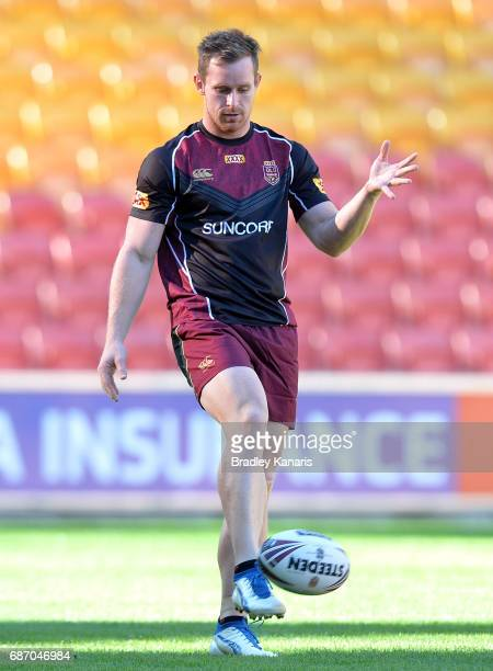 Michael Morgan kicks the ball during a Queensland Maroons State of Origin training session at Suncorp Stadium on May 23 2017 in Brisbane Australia