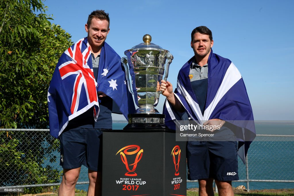 Michael Morgan of Australia and Lachlan Coote of Scotland pose with the Rugby League World Cup during a 2017 Rugby League World Cup Media Opportunity on June 11, 2017 in Darwin, Australia.