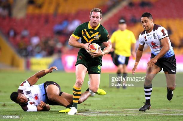 Michael Morgan of Australia breaks through the defence during the 2017 Rugby League World Cup Semi Final match between the Australian Kangaroos and...