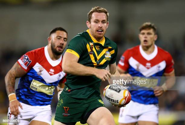 Michael Morgan of Australia makes a line break during the 2017 Rugby League World Cup match between Australian Kangaroos and France at Canberra...