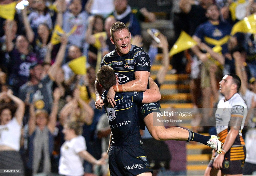 Michael Morgan of the Cowboy is congratulated by team mate Coen Hess after scoring a try during the first NRL semi final between North Queensland Cowboys and Brisbane Brisbane at 1300SMILES Stadium on September 16, 2016 in Townsville, Australia.
