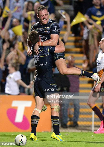 Michael Morgan of the Cowboy is congratulated by team mates after scoring a try during the first NRL semi final between North Queensland Cowboys and...