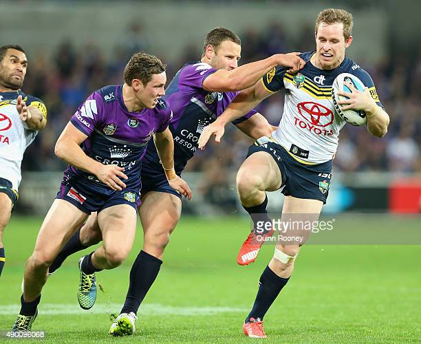 Michael Morgan of the Cowboys breaks through a tackle during the NRL Second Preliminary Final match between the Melbourne Storm and the North...