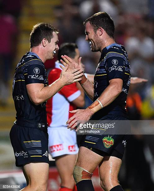 Michael Morgan of the Cowboys celebrates after scoring a try with Gavin Cooper of the Cowboys during the round eight NRL match between the North...