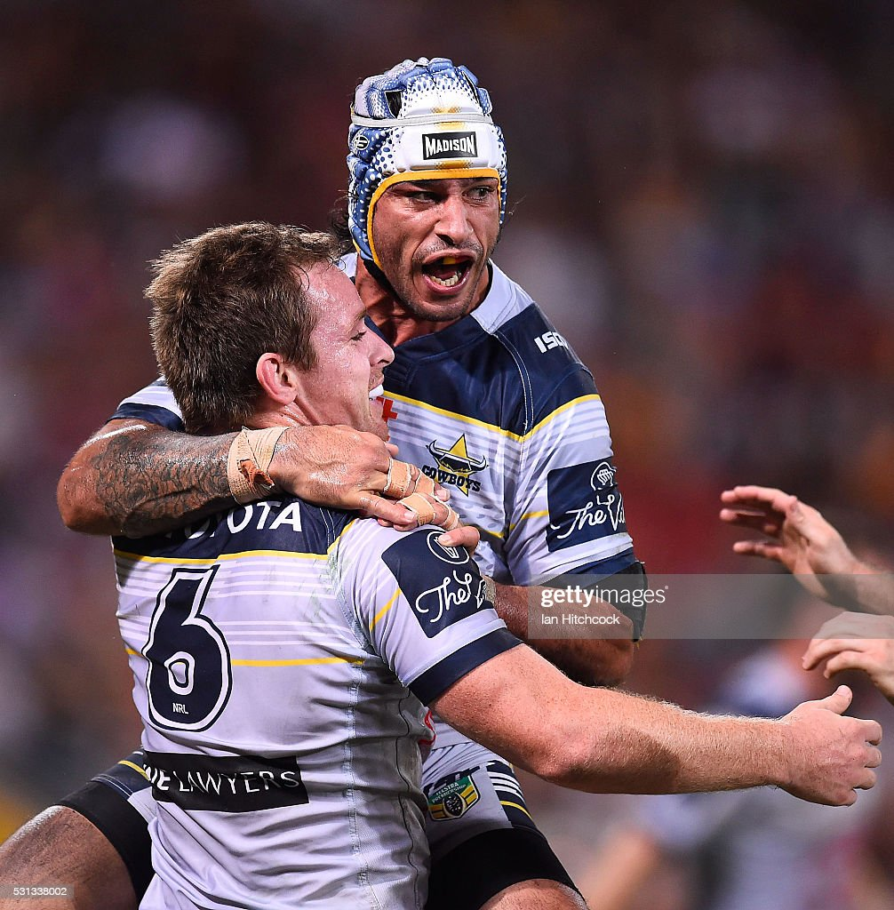 Michael Morgan of the Cowboys celebrates after scoring a try with Johnathan Thurston during the round 10 NRL match between the Melbourne Storm and the North Queensland Cowboys at Suncorp Stadium on May 14, 2016 in Brisbane, Australia.