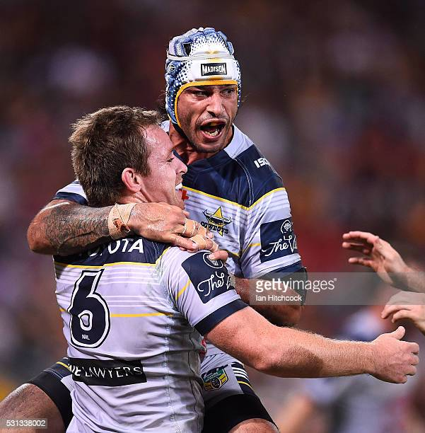 Michael Morgan of the Cowboys celebrates after scoring a try with Johnathan Thurston during the round 10 NRL match between the Melbourne Storm and...