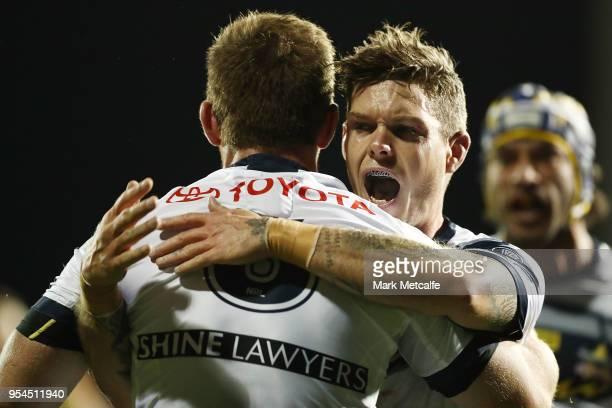 Michael Morgan of the Cowboys celebrates scoring a try with team mates during the round nine NRL match between the Penrith Panthers and the North...
