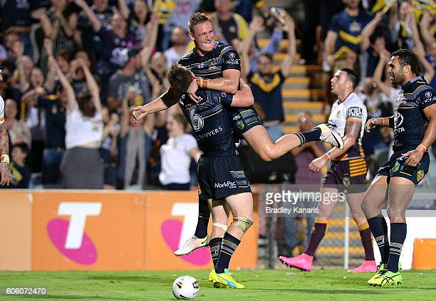 Michael Morgan of the Cowboys is congratulated by team mate Coen Hess after scoring a try during the first NRL semi final between North Queensland...