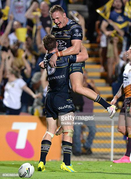 Michael Morgan of the Cowboys is congratulated by team mates after scoring a try during the first NRL semi final between North Queensland Cowboys and...