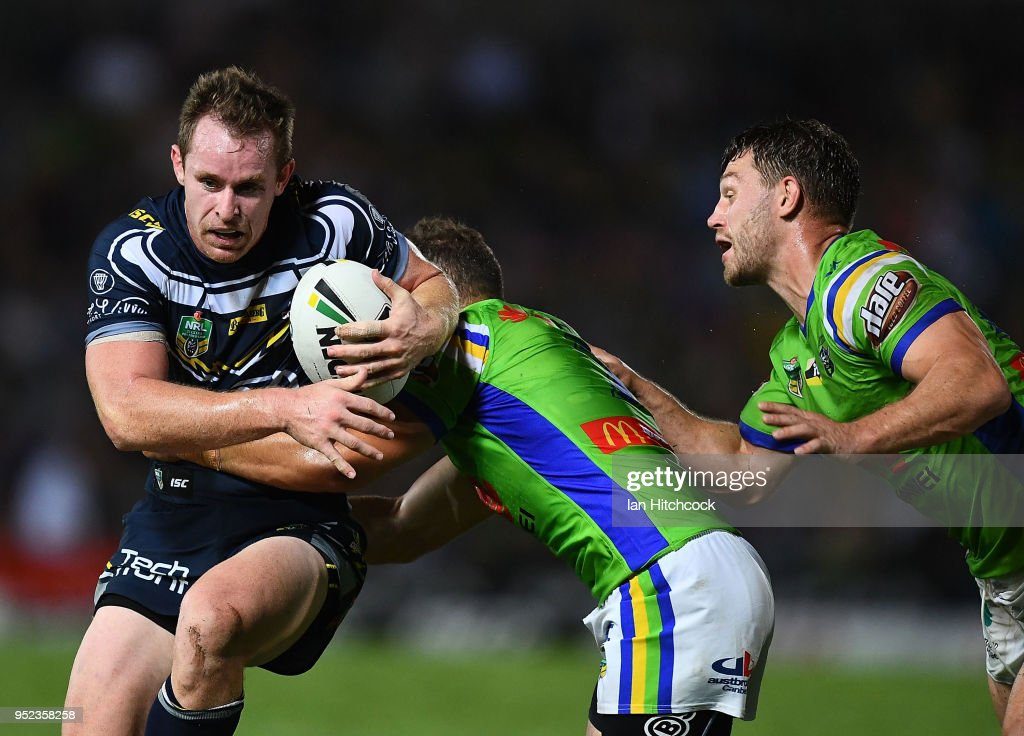 Michael Morgan of the Cowboys is tackled by Aidan Sezer of the Raiders during the round eight NRL match between the North Queensland Cowboys and the Canberra Raiders at 1300SMILES Stadium on April 28, 2018 in Townsville, Australia.