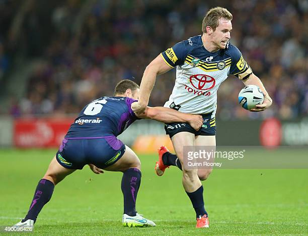 Michael Morgan of the Cowboys is tackled by Blake Green of the Storm during the NRL Second Preliminary Final match between the Melbourne Storm and...