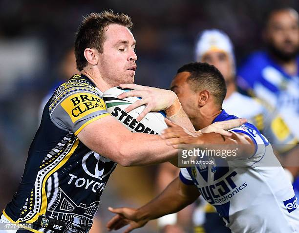 Michael Morgan of the Cowboys is tackled by Moses Mbye of the Bulldogs during the round nine NRL match between the North Queensland Cowboys and the...