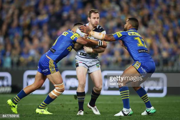Michael Morgan of the Cowboys is tackled during the NRL Semi Final match between the Parramatta Eels and the North Queensland Cowboys at ANZ Stadium...