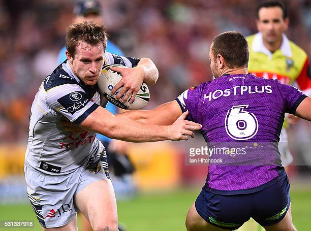 Michael Morgan of the Cowboys looks to get past Blake Green of the Storm during the round 10 NRL match between the Melbourne Storm and the North...