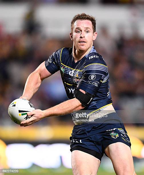 Michael Morgan of the Cowboys looks to pass the ball during the round 24 NRL match between the North Queensland Cowboys and the New Zealand Warriors...