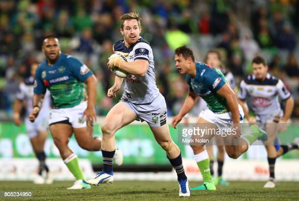 Michael Morgan of the Cowboys makes a line break toset up a try during the round 17 NRL match between the Canberra Raiders and the North Queensland...