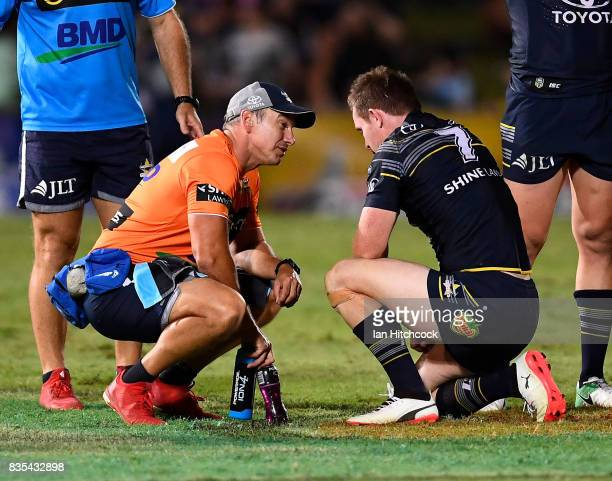 Michael Morgan of the Cowboys receives treatment after being injured during the round 24 NRL match between the North Queensland Cowboys and the...