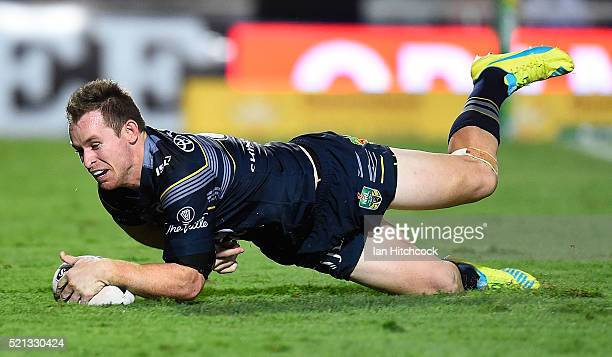Michael Morgan of the Cowboys scores a try during the round seven NRL match between the North Queensland Cowboys and the South Sydney Rabbitohs at...
