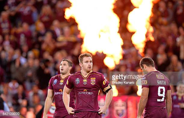 Michael Morgan of the Maroons runs onto the field of play during game two of the State Of Origin series between the Queensland Maroons and the New...