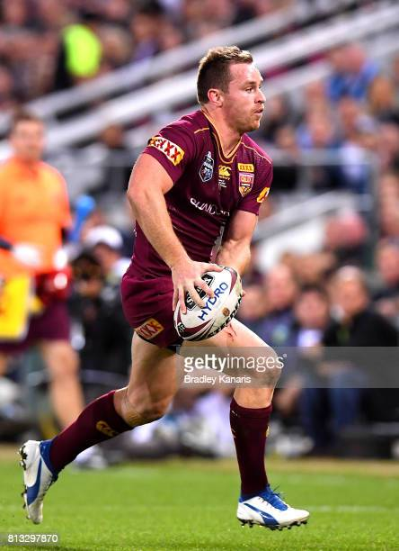 Michael Morgan of the Maroons runs with the ball during game three of the State Of Origin series between the Queensland Maroons and the New South...