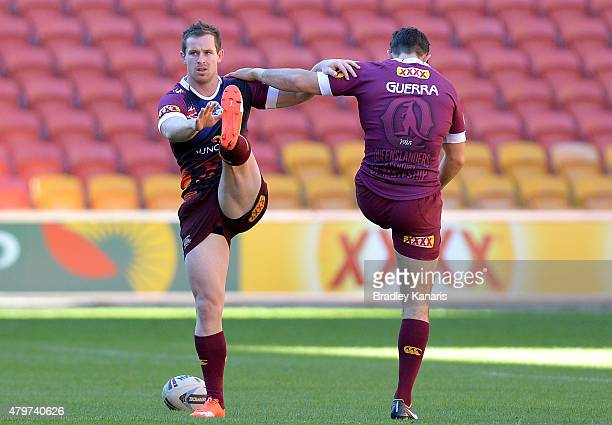 Michael Morgan warms up during the Queensland Maroons State of Origin captain's run at Suncorp Stadium on July 7 2015 in Brisbane Australia