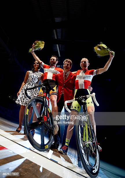 Michael Morkov and Alex Rasmussen of Denmark celebrate their lead in the race during the Copenhagen Six Days Cycling Race at Ballerup Super Arena on...