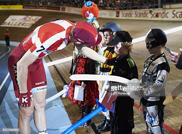 Michael Morkov gives the prize for Fastelavn best costume for kids competition during day four at the Copenhagen Six Days race at Ballerup Super...