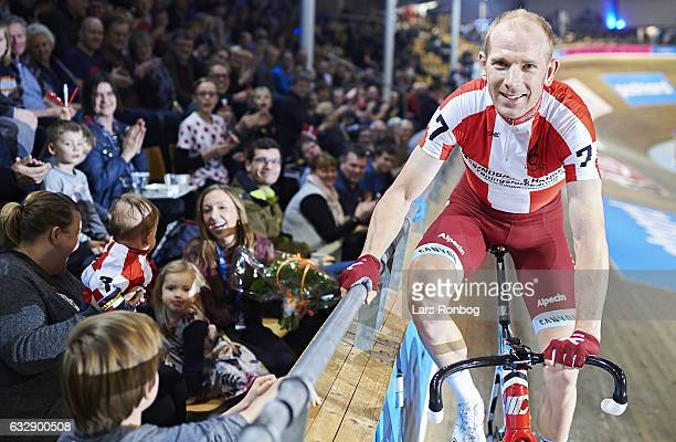 Michael Morkov of Denmark giving his flowers to the family after winning the derby pace during day three at the Copenhagen Six Days race at Ballerup...