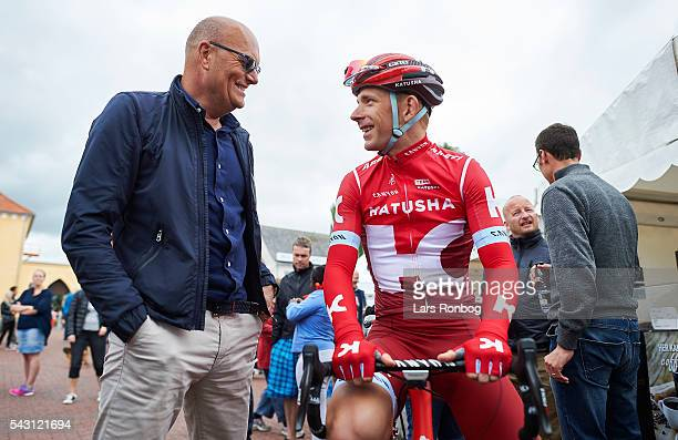 Michael Morkov of Team KATUSHA speaks to Bjarne Riis prior to the Elite Men Road Race Championships on day three of the Danish Cycling Championships...