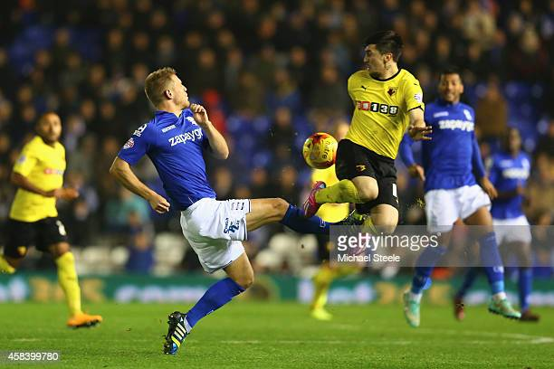 Michael Morrison of Birmingham City challenges Fernando Forestieri of Watford during the Sky Bet Championship match between Birmingham City and...