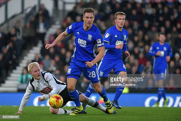 Michael Morrison of Birmingham City gets away fro Will Hughes of Derby County during the Sky Bet Championship match between Derby County and...